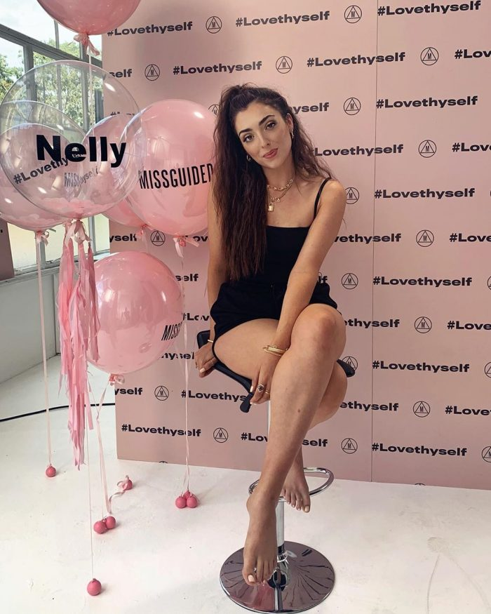 Nelly behind the scenes on stool