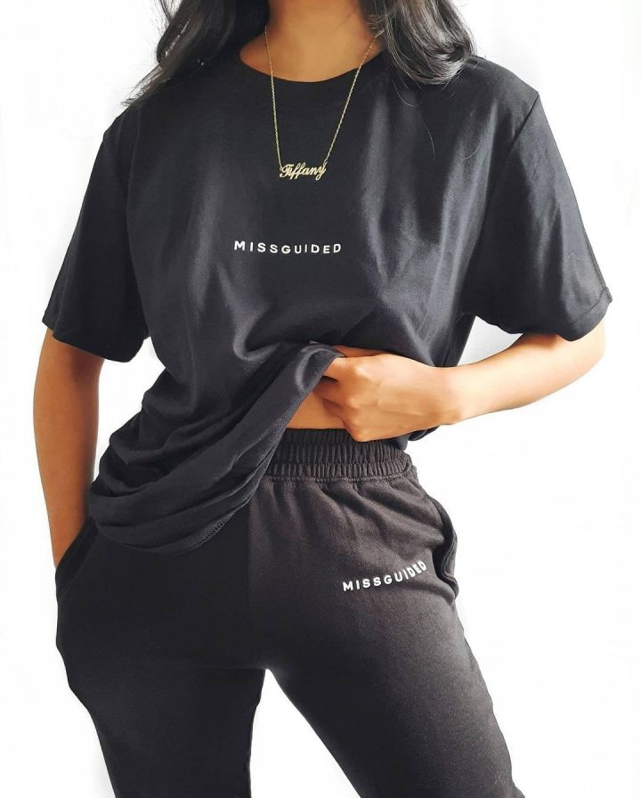 all black matching loungewear set with missguided slogan