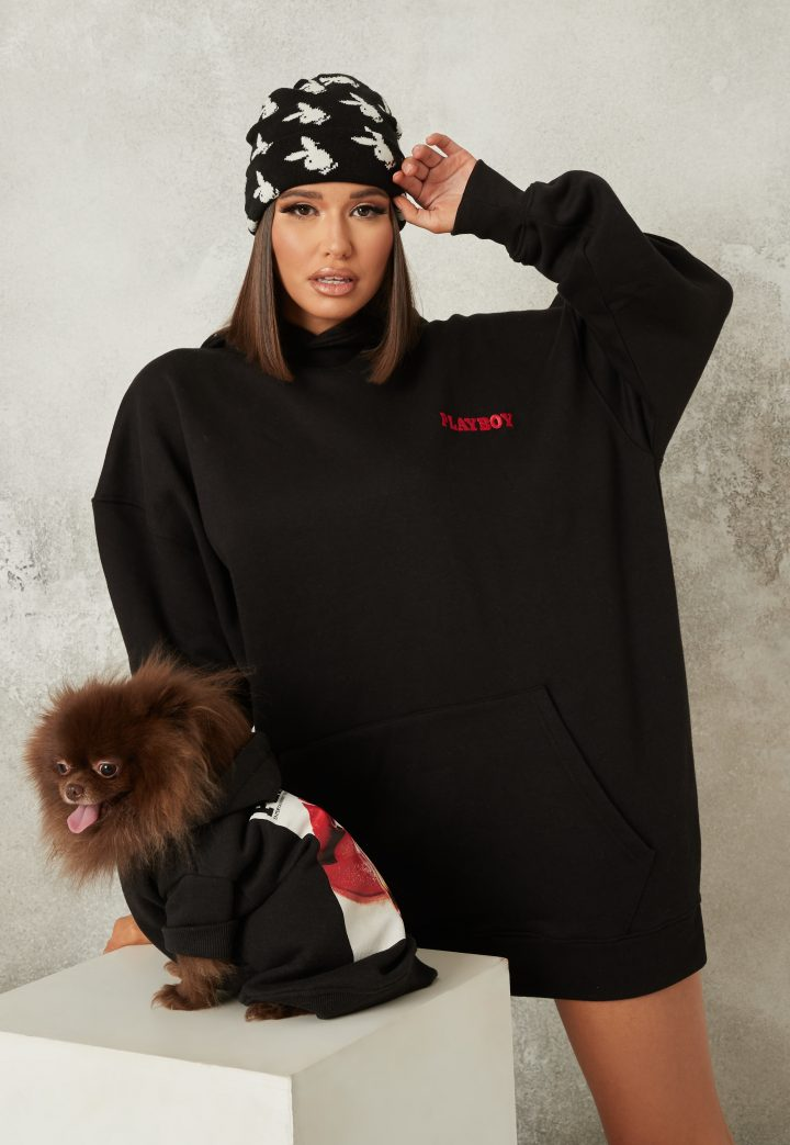 Girl in black hoodie with dog playboy jumpers
