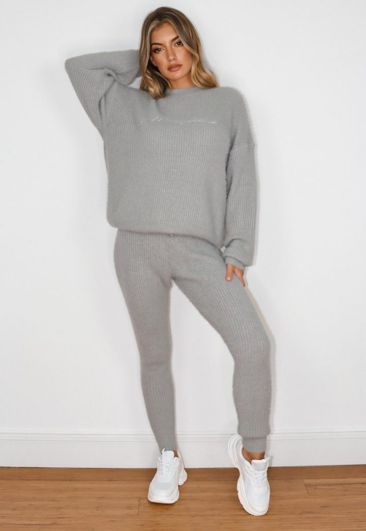 Girl wearing grey knitted jumper and leggings