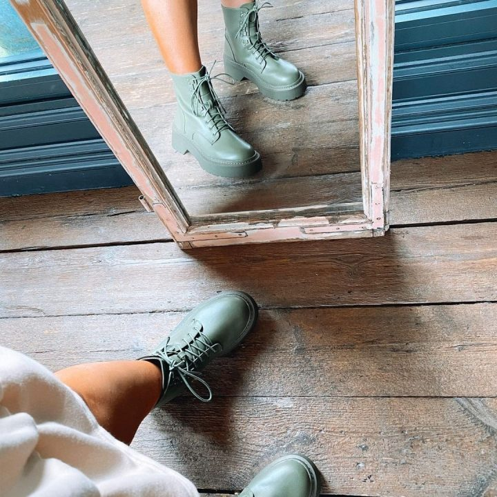 Green boots taken in the mirror with reflection