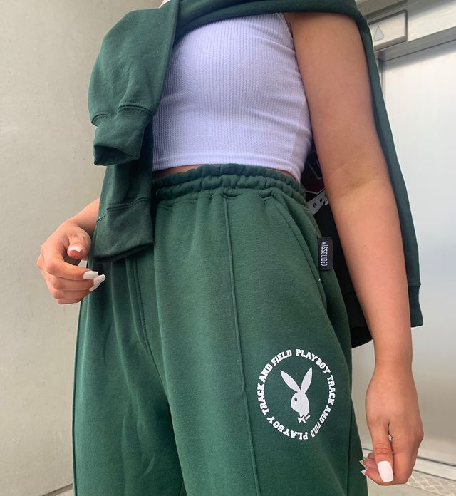 girl wearing green tracksuit