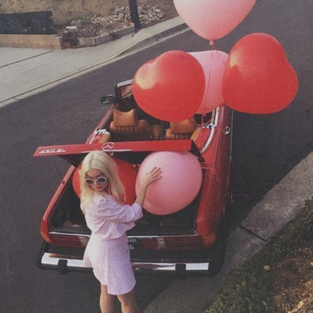 missguided Galentine's Day red car pink love heart balloons