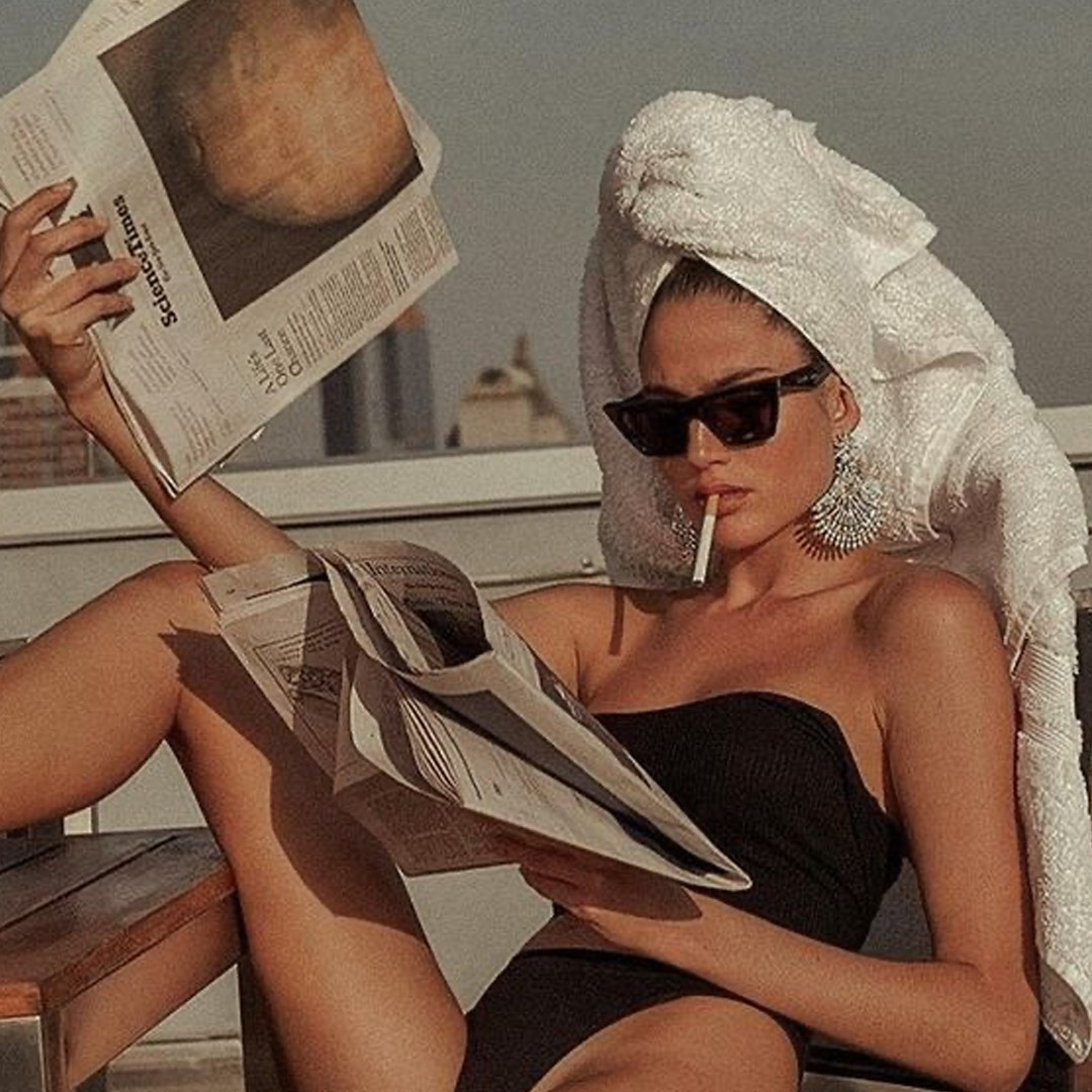 confidence missguided towel news papers black swimsuit glasses cigarette