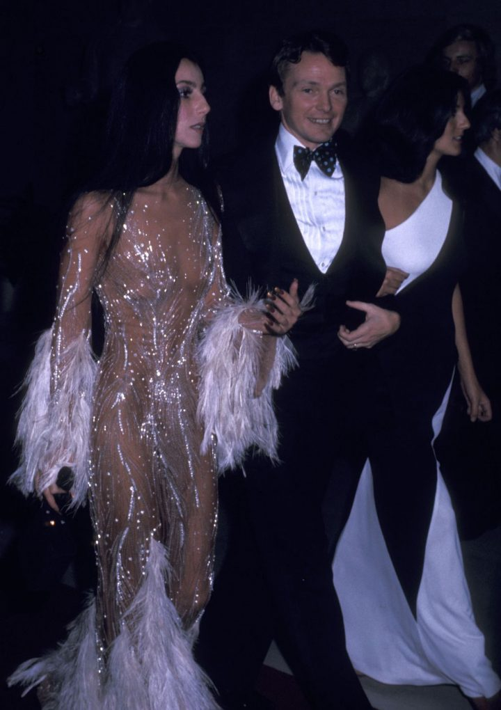 cher and sonny wearing diamante dress with feather sleeves