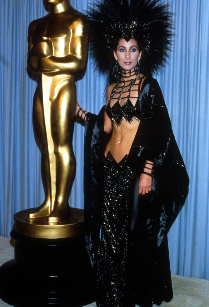 cher at the oscars with black head dress on
