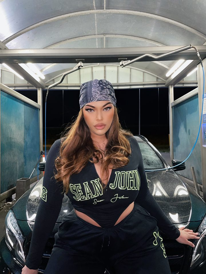 girl wearing headscarf and black top leaning on car