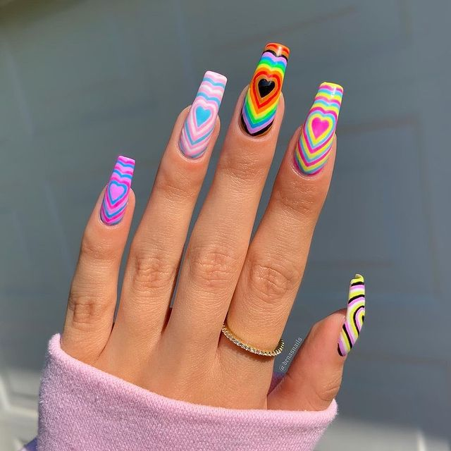 pride nail art with different coloured hearts