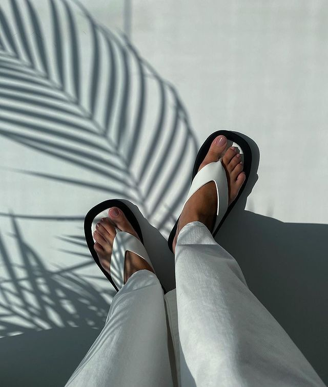 coconut girl aesthetic chunky sandals and palm leaf